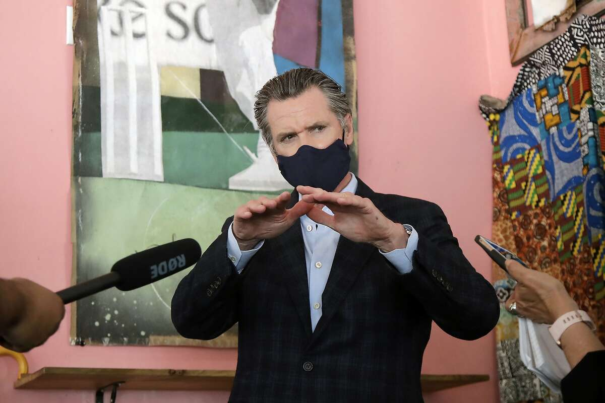Gov. Gavin Newsom wears a protective mask on his face while speaking to reporters at Miss Ollie's restaurant during the coronavirus outbreak in Oakland, Calif., Tuesday, June 9, 2020. (AP Photo/Jeff Chiu, Pool)