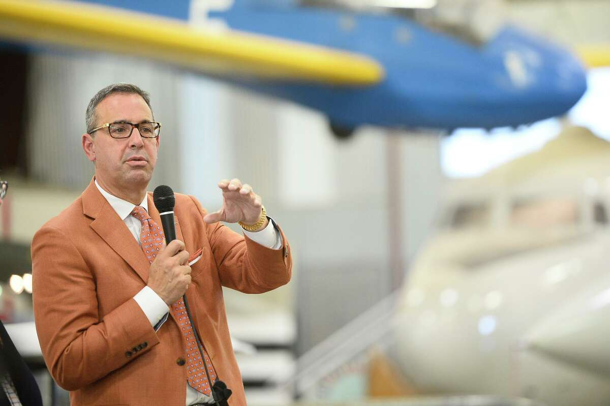 Texas Exes and University of Texas Athletics Department passed through Midland on the This Is Texas Tour featuring athletics program leaders including head football coach Tom Herman, April 24, 2018, at the Commemorative Air Force museum hanger. Pictured, Chris Del Conte, athletics director, speaks during the event. James Durbin/Reporter-Telegram