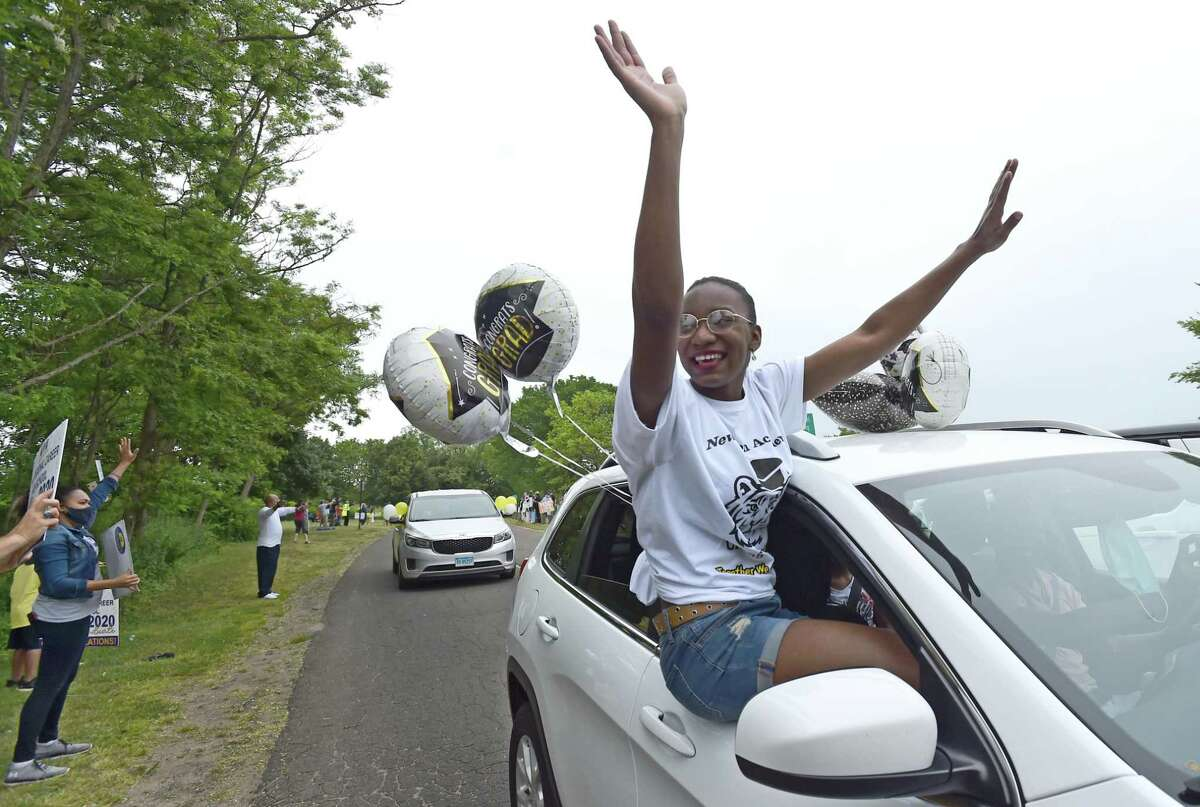 Graduates-to-be stood through sunroofs, hung out of windows and held signs as they passed by school officials. Many filmed the experience on their phones, grinning ear-to-ear. Midway through the event, a plane flew overhead with a banner congratulating the class of 2020. Although many appeared to have fun during the parade, several students conceded that it wasn't their first choice for a graduation ceremony.