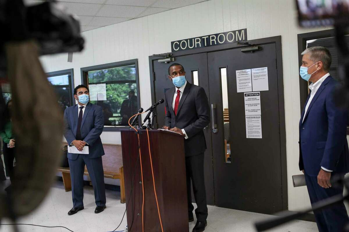 Judge Jeremy Brown, Harris County Justice of the Peace Precinct 7, Place 1, speaks during a press conference with State Rep. Armando Walle, left, the Harris County Recovery Czar, and Marvin Odum, right, the City of Houston COVID-19 Relief and Recovery Czar, Thursday, June 11, 2020, in Houston.