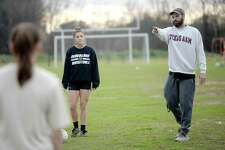 Coach Aaron Tomplait offers instruction as members of the Nederland girls soccer team get in practice Monday as they prepare for an upcoming district game. The Lady Bulldogs are looking to maintain their record of claiming the district title this season. Photo taken Monday, Jan. 27, 2020 Kim Brent/The Enterprise