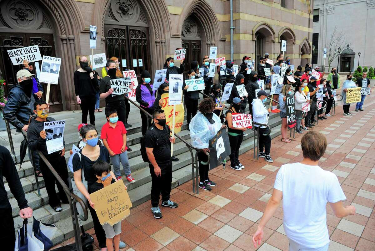 Over 50 people with Unidad Latina en Accion hold a black-brown unity march to protest police brutality against black people and Latinos in New Haven on Thursday, June 11.