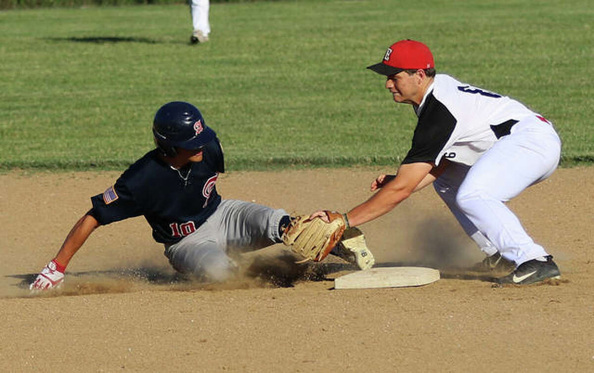 Alton's Owen Macias (left) gets a foot to the bag to beat the tag from Elsberry's second baseman on a pickoff throw Thursday night in Elsberry, Missouri.