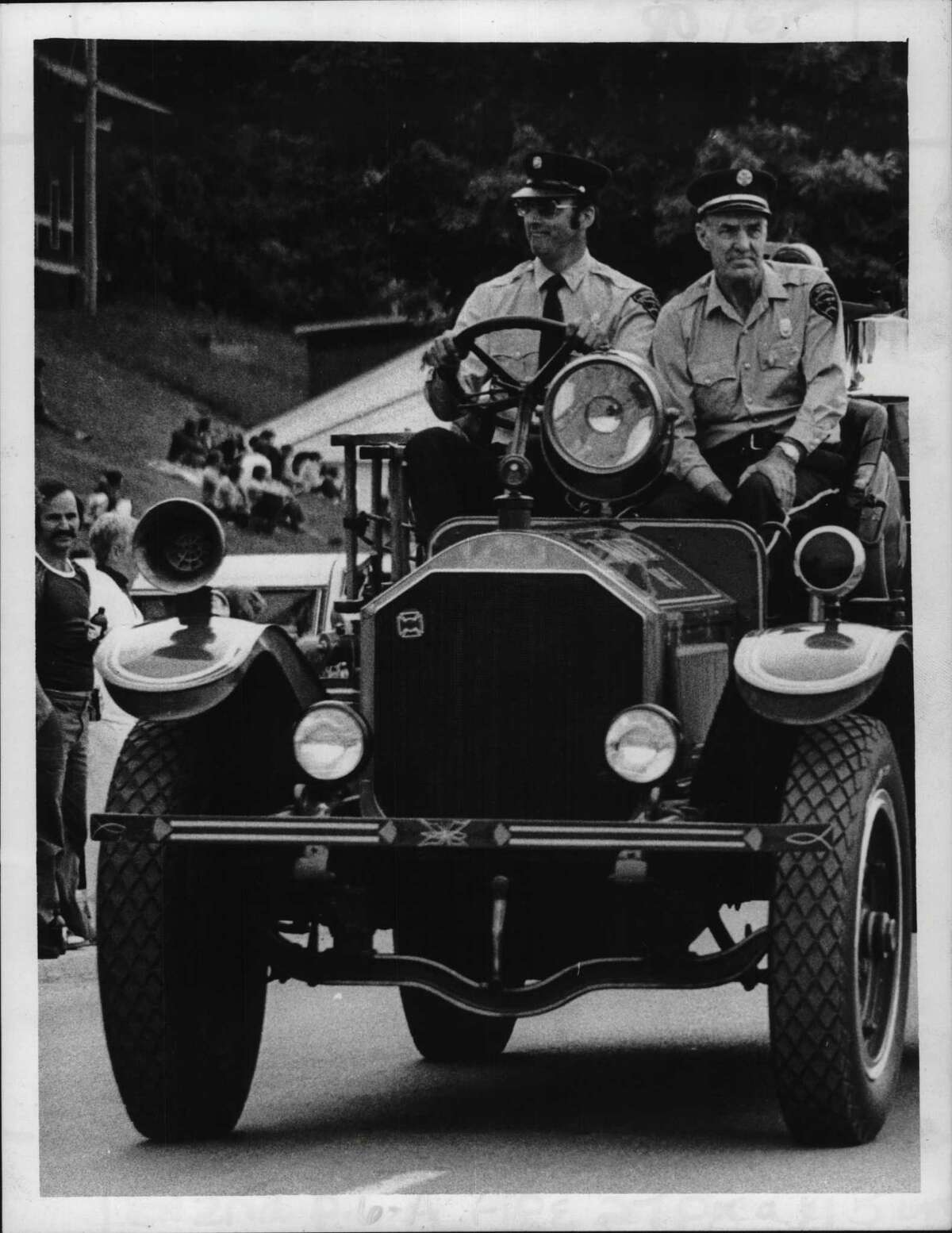 Firemen from the North Queensbury Fire Department parade their antique fire engine along the main street of Lake George as part of the Hudson Valley Firemen's Convention over the weekend. Over 8,000 firemen took part in the dress parade bringing fire units from the eastern section of New York, from Westchester County to the Canadian border. June 12, 1978 (Times Union Archive)