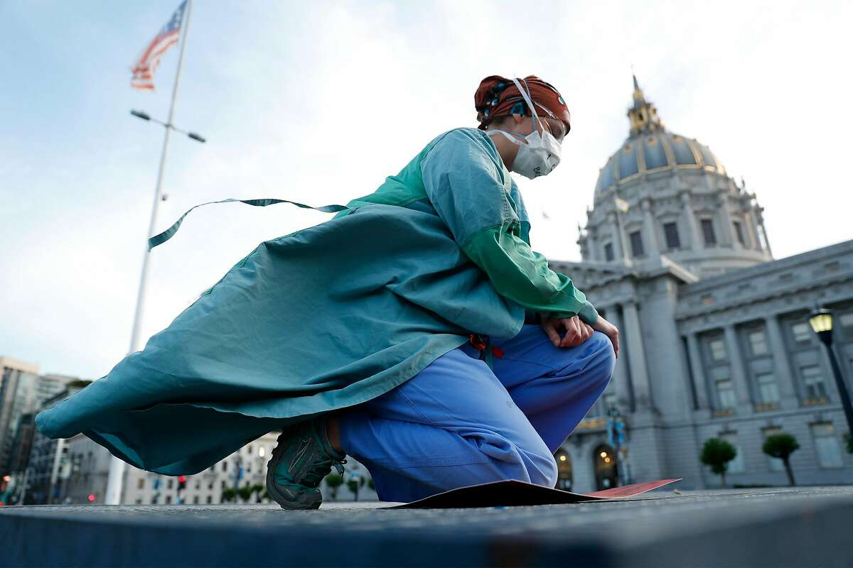 In reaction to death of George Floyd, Kate Weber joins Nurses for Racial Justice as they lie and kneel outside City Hall in San Francisco, Calif., on Thursday, June 11, 2020.