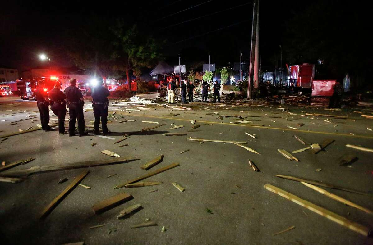 Houston Fire Dept. inspect a building explosion on Almeda Road in Houston on Friday, June 12, 2020.