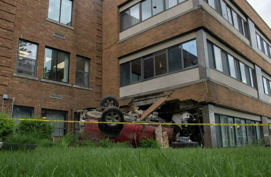 Car remains lay behind caution tape June 12 after crashing into the first floor, the Chapel, around midnight at the Huron Count Medical Care Facility. Photo: Aurora Abraham/Huron Daily Tribune