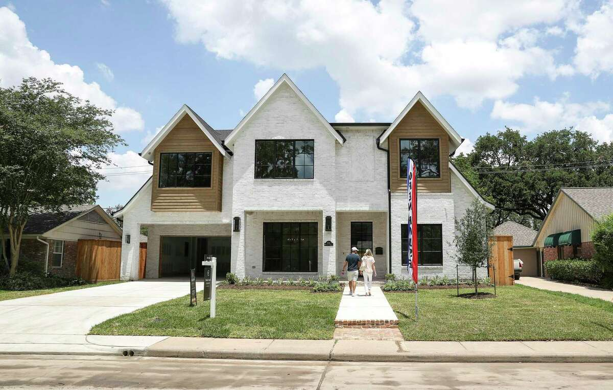 A couple walks in to an open house Thursday, June 4, 2020, in the Briargrove neighborhood in Houston.
