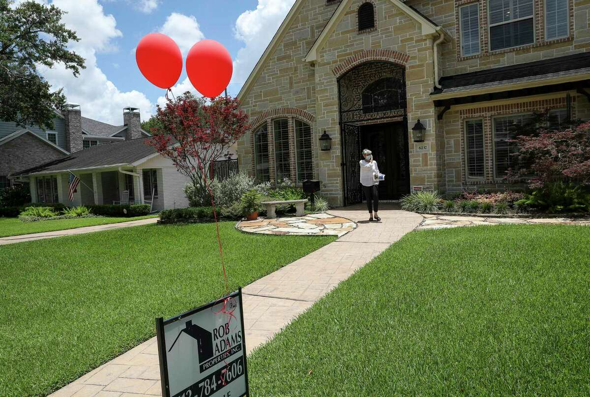 """Estelle Elles, a realtor, leaves an open house Thursday, June 4, 2020, in the Briargrove neighborhood in Houston. """"The market is generally OK for me,"""" she said. """"I can't talk for everyone."""""""
