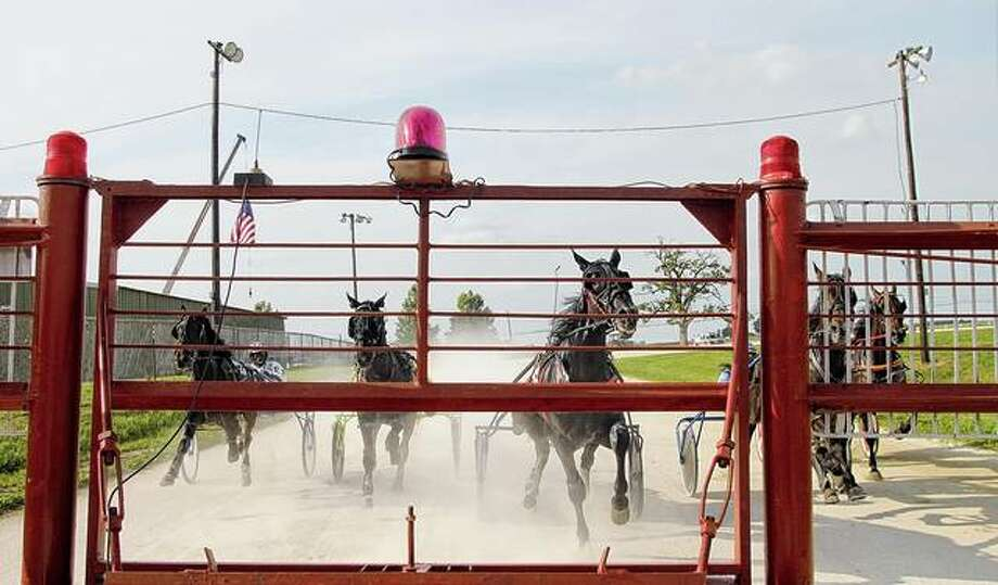 Horses and drivers prepare for the start of racing at last year's Greene County Fair. This year's event, originally scheduled for June 20-27, has been cancelled. Photo: Rosalind Essig | Journal-Courier