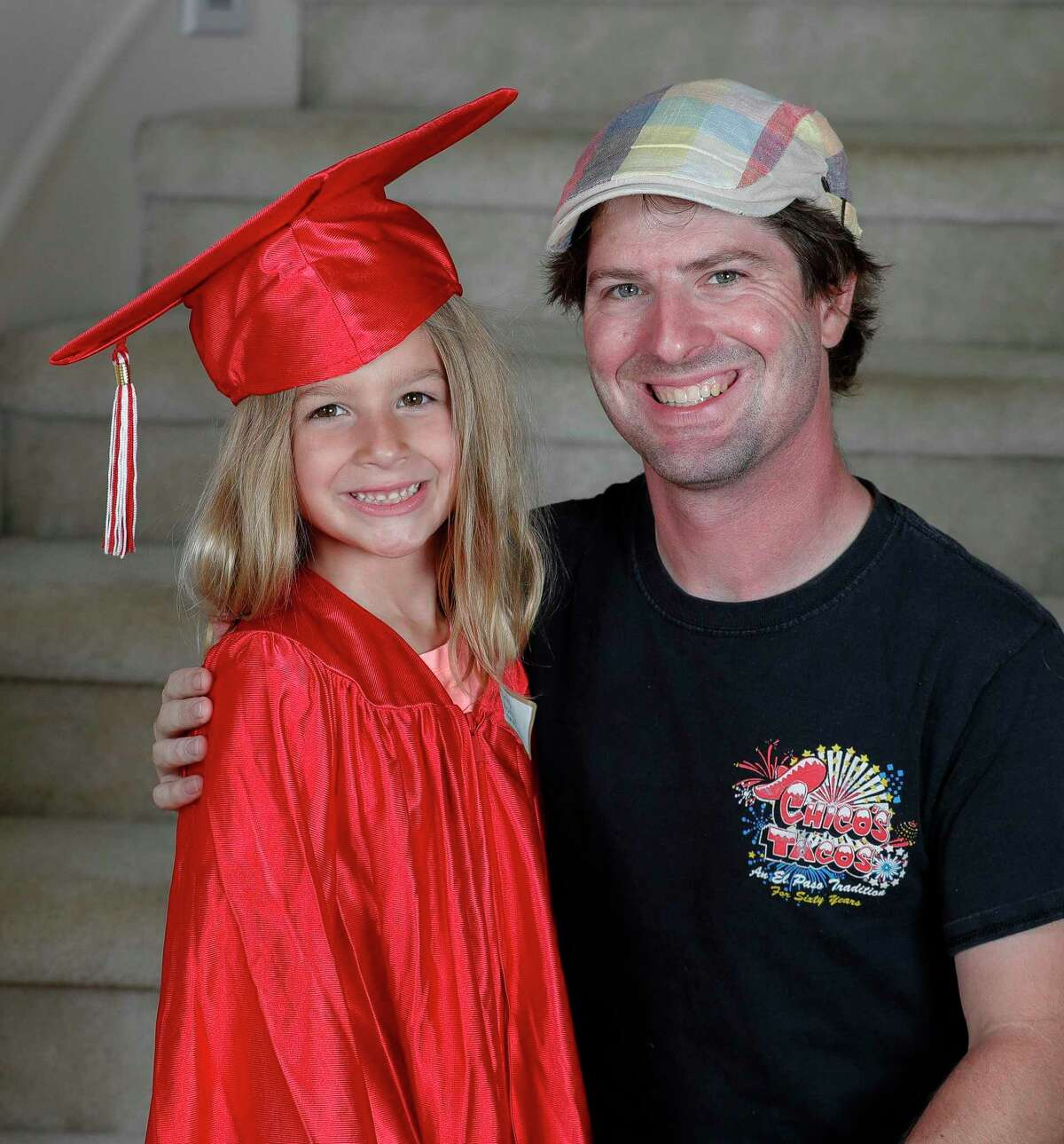 Courier photo editor Jason Fochtman is pictured with his oldest daughter, Emma, at her kindergarten graduation recently. He said his world became very small when she was born in the summer of 2014. Now he focuses on controling what he can control while covering floods, pandemics and more.