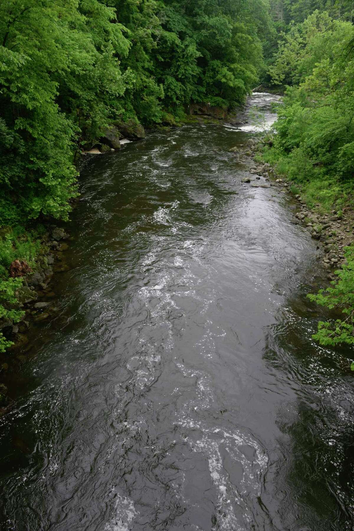 The Housatonic River running through the First Light Bulls Bridge Recreation Area near where two New York men were reported missing Wednesday while swimming in the river in Kent.