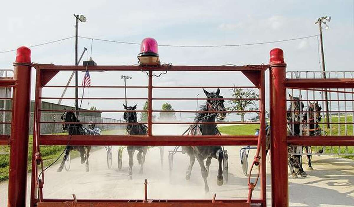 Horses and drivers prepare for the start of racing at last year's Greene County Fair. This year's event, originally scheduled for June 20-27, has been cancelled.