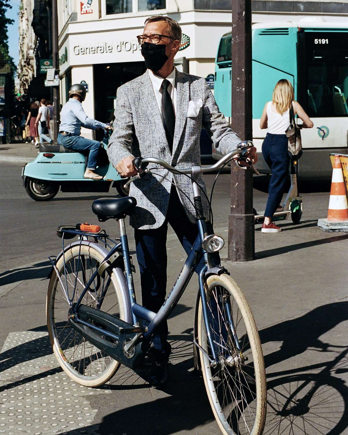Christophe Tafforeau, 52, a commercial director at a job training agency, with his bicycle outside his office in Paris on May 19, 2020. As European cities emerge from quarantines, bicycles are playing a central role in getting the work force moving again. (Maxime La/The New York Times)
