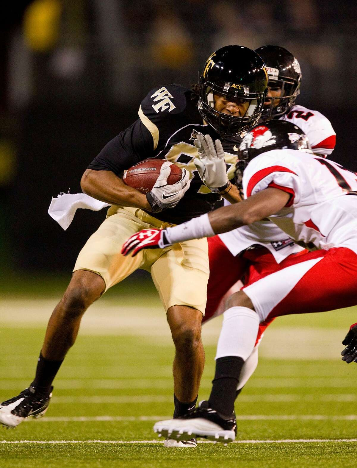 WINSTON SALEM, NC - SEPTEMBER 17: Matt James #87 of the Wake Forest Demon Deacons braces for a hit from Kamar Morrison #13 of the Gardner-Webb Bulldogs at BB&T Field on September 17, 2011 in Winston Salem, North Carolina. The Demon Deacons defeated the Runnin' Bulldogs 48-5. (Photo by Brian A. Westerholt/Getty Images)