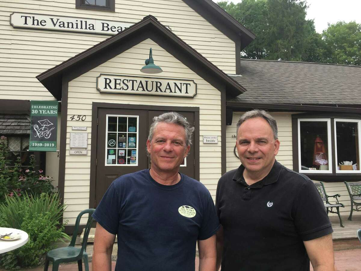 Brian Jessurun, left, and Barry Jessurun stand in front of the Vanilla Bean Cafe that they own in Pomfret. The brothers are also co-owners of the Dog Lane Cafe in Storrs, 85 Main in Putnam and Fenton River Grill in Mansfield Center.