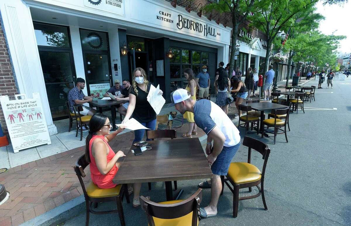 Area restaurants begin to transform Bedford Street into outdoor Streateries on May 30 in Stamford.