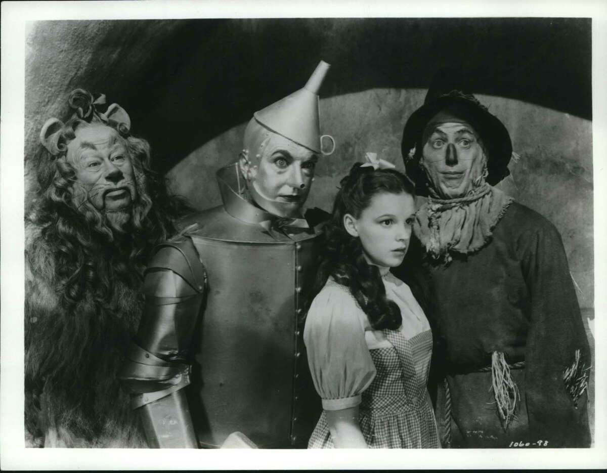 """(From left to right) Bert Lahr, as the Cowardly Lion, Jack Haley as the armor-plated Tin Woodsman, Judy Garland as the transplanted Dorothy and elastic-legged Ray Bolger as the dancing Scarecrow star in the classic motion picture """"The Wizard of Oz."""""""