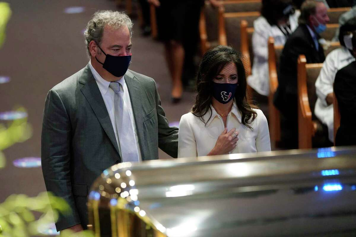 Cal McNair, chairman and chief executive officer of the Houston Texans, left, pauses by the casket of George Floyd during a funeral service for Floyd at The Fountain of Praise church Tuesday, June 9, 2020, in Houston. (AP Photo/David J. Phillip, Pool)