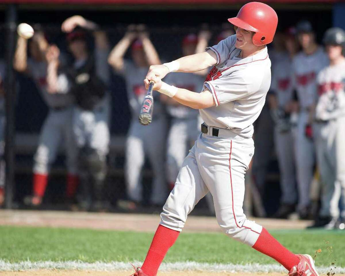 Pomperaug's Kevin Foley belts a double to left center against New Fairfield Thursday at New Fairfield High.
