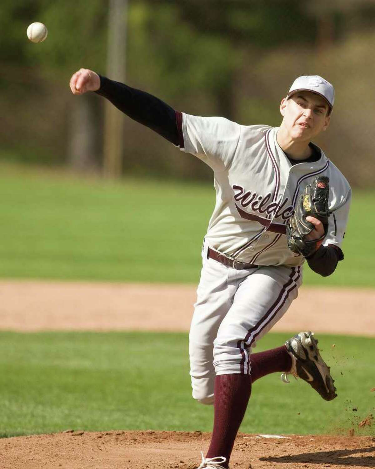 Bethel's John Simonelli fires a pitch against SWC rival Pomperaug Monday at Bethel High.