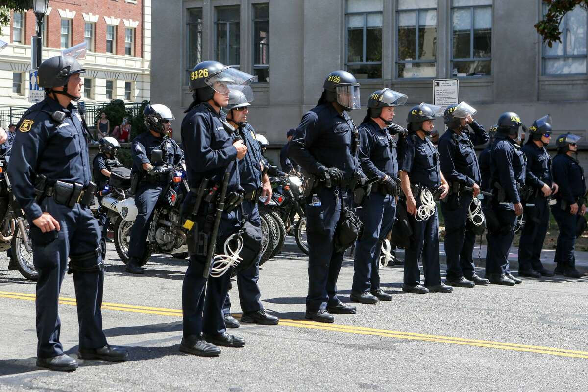 FILE PHOTO: Riot police form a blockade during a No To Marxism rally on Aug. 27, 2017 at Martin Luther King Jr. Park in Berkeley, Calif. The City Council will consider a proposal next week to prohibit the police officers from conducting traffic stops, shifting that responsibility to unarmed public works officials.