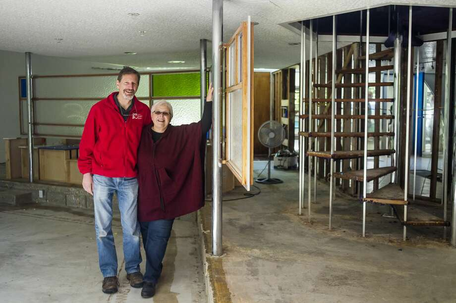 Carol and Leonard Bogan pose or a portrait Friday morning in their home on W. Sugnet Road, which was flooded with several feet of water. The dome-shaped structure was designed by Robert E. Shwartz in the mid-century modern style, and construction began in 1964. (Katy Kildee/kkildee@mdn.net) Photo: (Katy Kildee/kkildee@mdn.net)