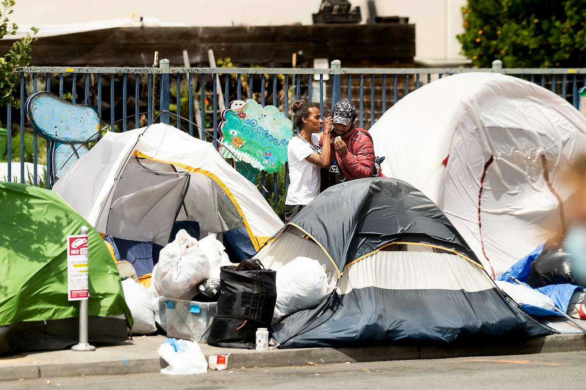 Tents line a McAllister St. sidewalk on the same block as UC Hastings College of the Law on Thursday, June 11, 2020, in San Francisco.