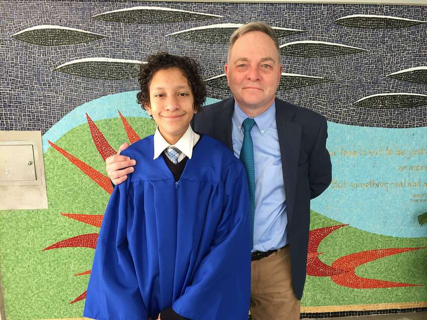 Kevin Fisher-Paulson with his son Aidan, celebrating his graduations from Saint John's School.
