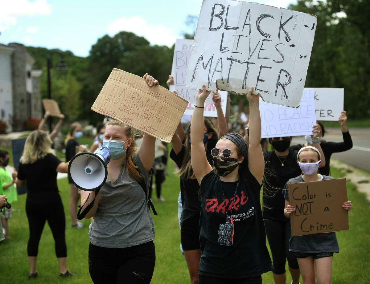 Protesters march and chant slogans during a Black Lives Matter peaceful protest on Route 67 in Oxford.