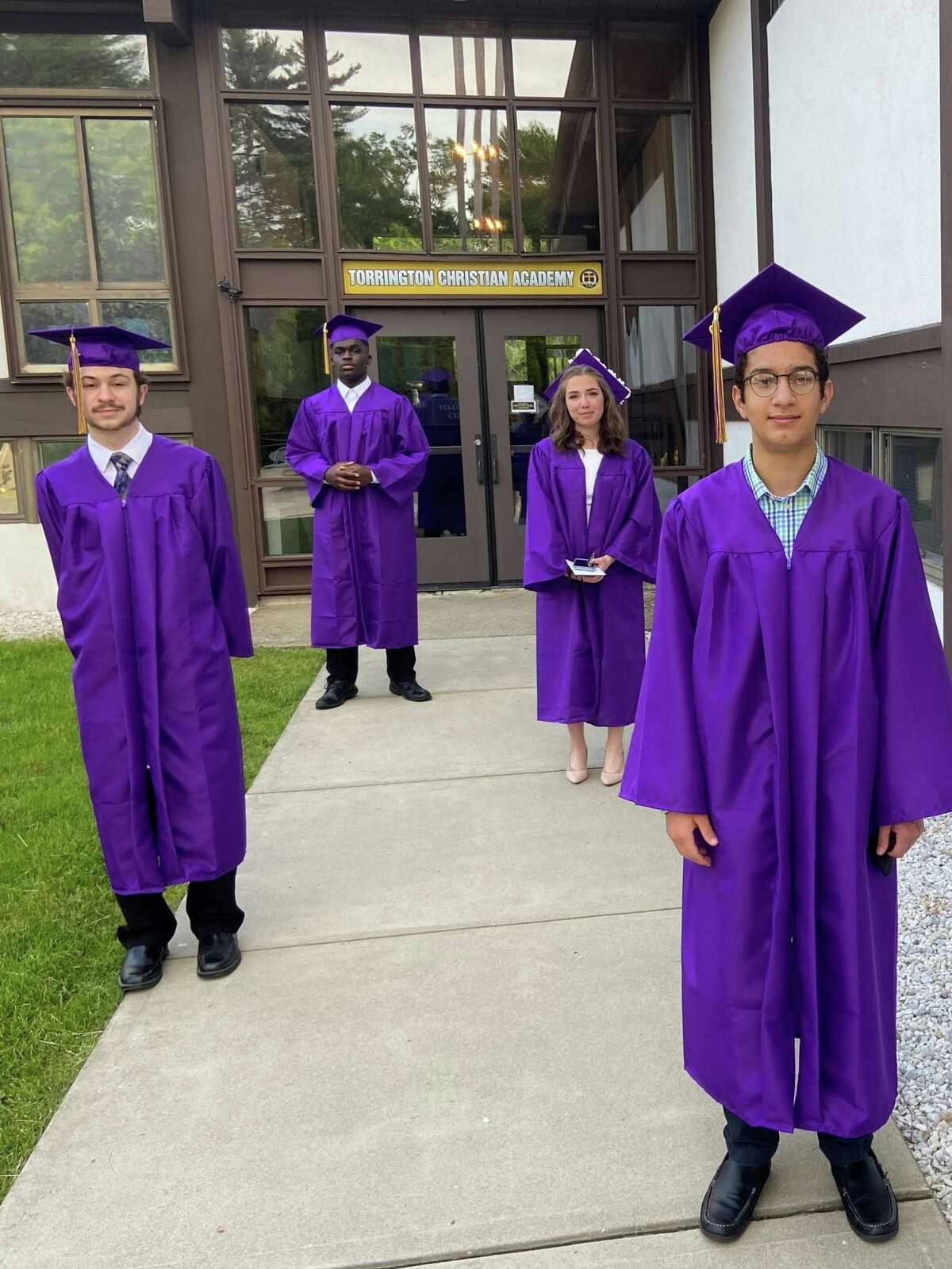 Torrington Christian Academy held its graduation ceremonies June 5. Seniors Andrea Lopez, Nathan Versari, and Damon Hopkins, all of Torrington, and David Fernandez of Naugatuck, are this year's graduates.