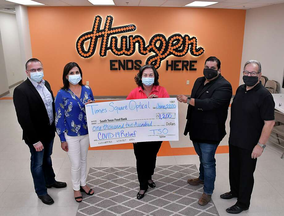 South Texas Food Bank Executive Director Alma Boubel, center, was presented with $1,200 donation from Carlos and Elsa Fuentes and Rene Garza of Times Square Optical, Thursday, June 11, 2020. Also pictured is Angelo Piccirillo, right, responsible for Business-Economic Development at The Business-Economic Development Center at TAMIU. Photo: Cuate Santos / Laredo Morning Times / Laredo Morning Times