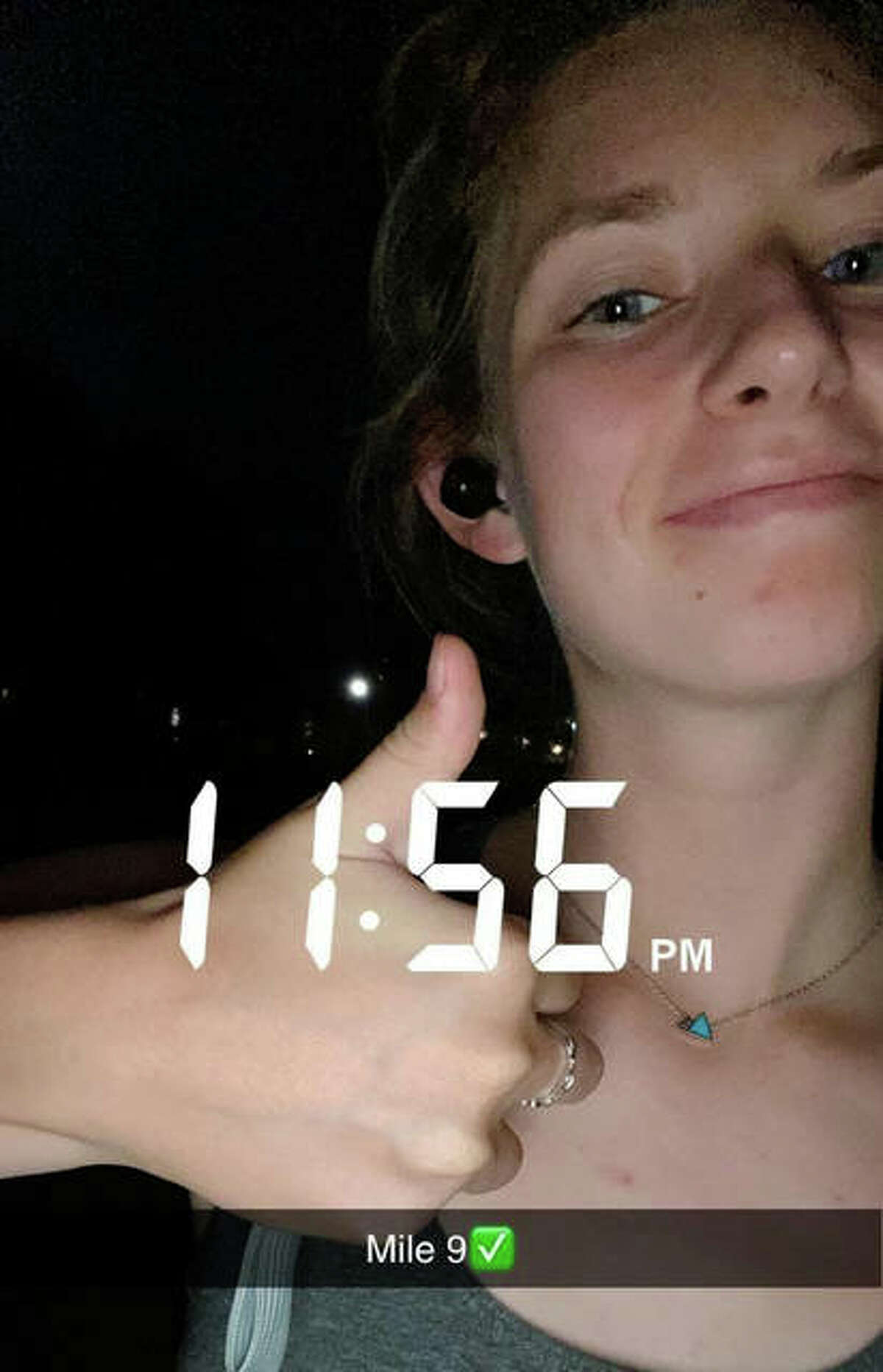 Wallace gives a thumbs up on her Snapchat after finishing mile nine.