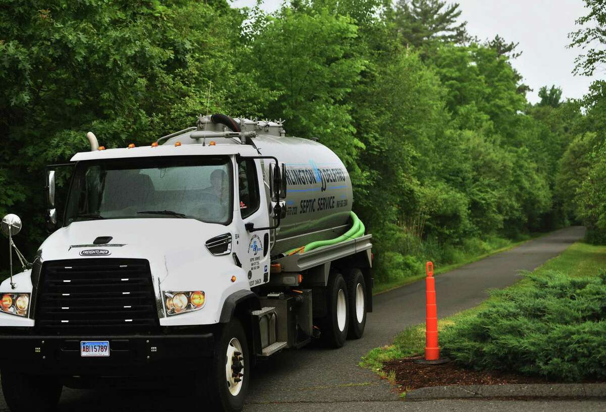 A septic service truck backs down the long driveway to the 44 Sky View Drive property once rented by Fotis and Jennifer Dulos in Avon, Conn. on Thursday, June 11, 2020. State police confirmed they were searching the home and property on Thursday for the missing New Canaan mother.