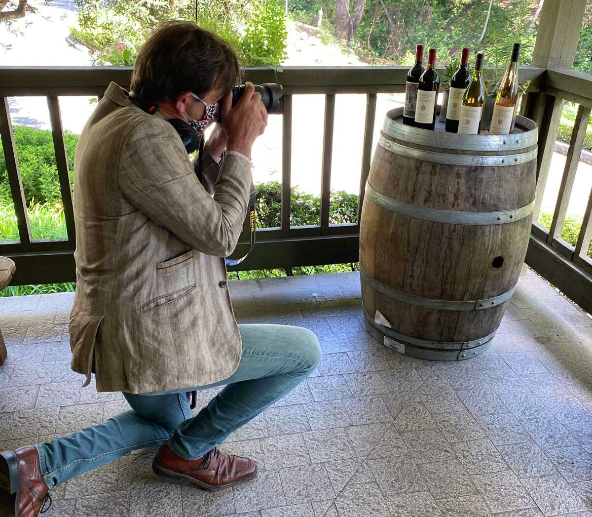 Geoffrey Curley photographs bottles at Alexander Valley Vineyards for use in a virtual tour of the winery in May.