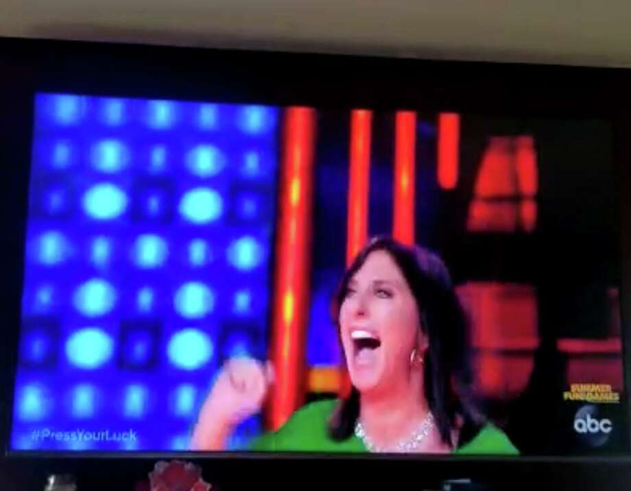Shelton resident Linda Cascella is shown celebrating in a television commercial promoting Press Your Luck, on which she will appear Sunday, June 14. Photo: Contributed Photo / Connecticut Post
