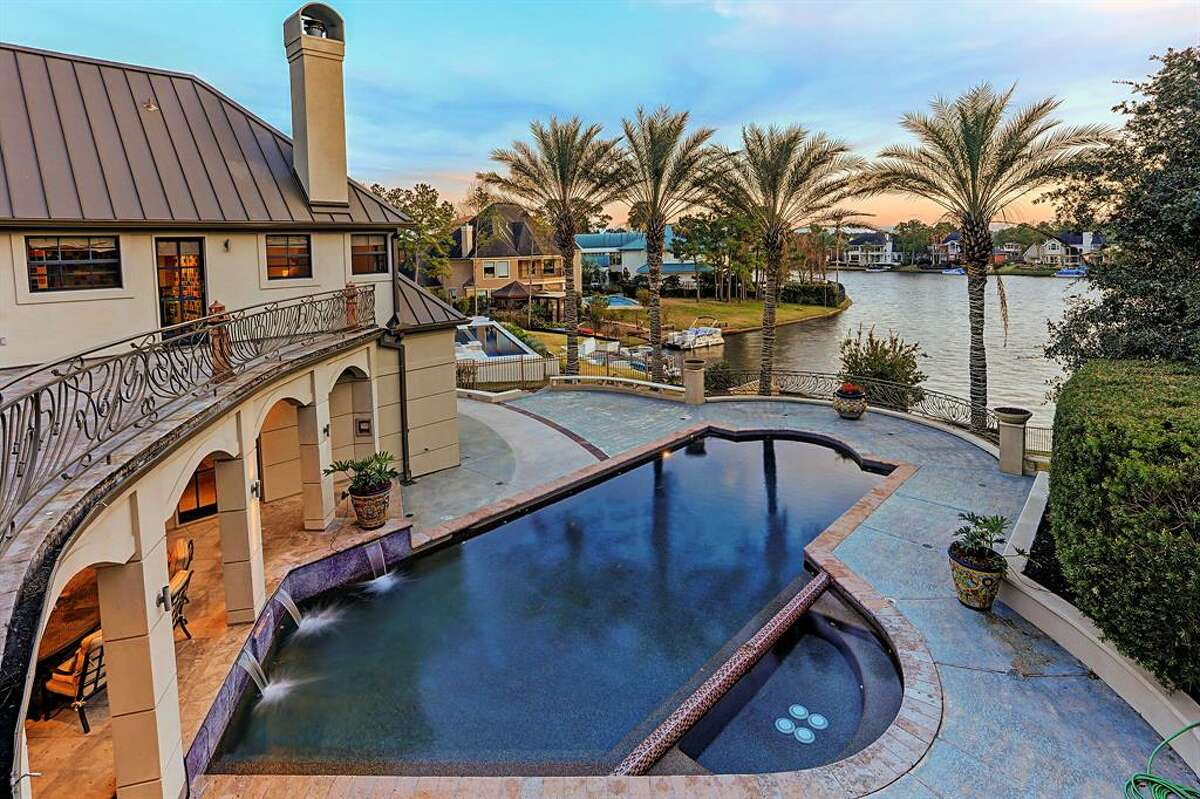 THE WOODLANDSOutside features a luxury pool that overlooks the lake.