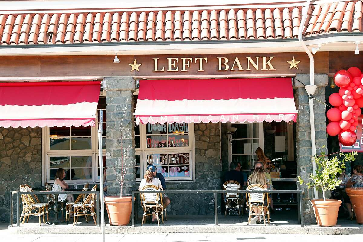 Diners sit out on the patio at Left Bank Brasserie in Larkspur, Calif., on Wednesday, June 10, 2020. The French restaurant is open for outdoor dining only.