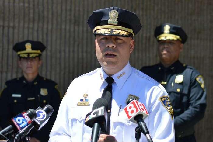 New Haven Police Chief Otoniel Reyes, center