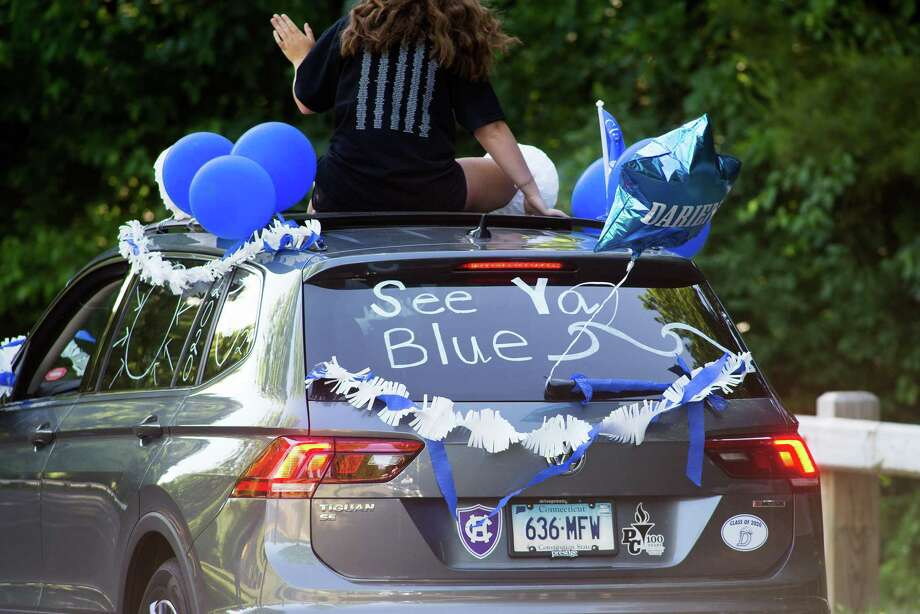 Darien High held a wave-through graduation car parade for the Class of 2020 seniors on the morning of June 12, after postponing it due to weather from June 11. Photo: Bryan Haeffele/Hearst Connecticut Media