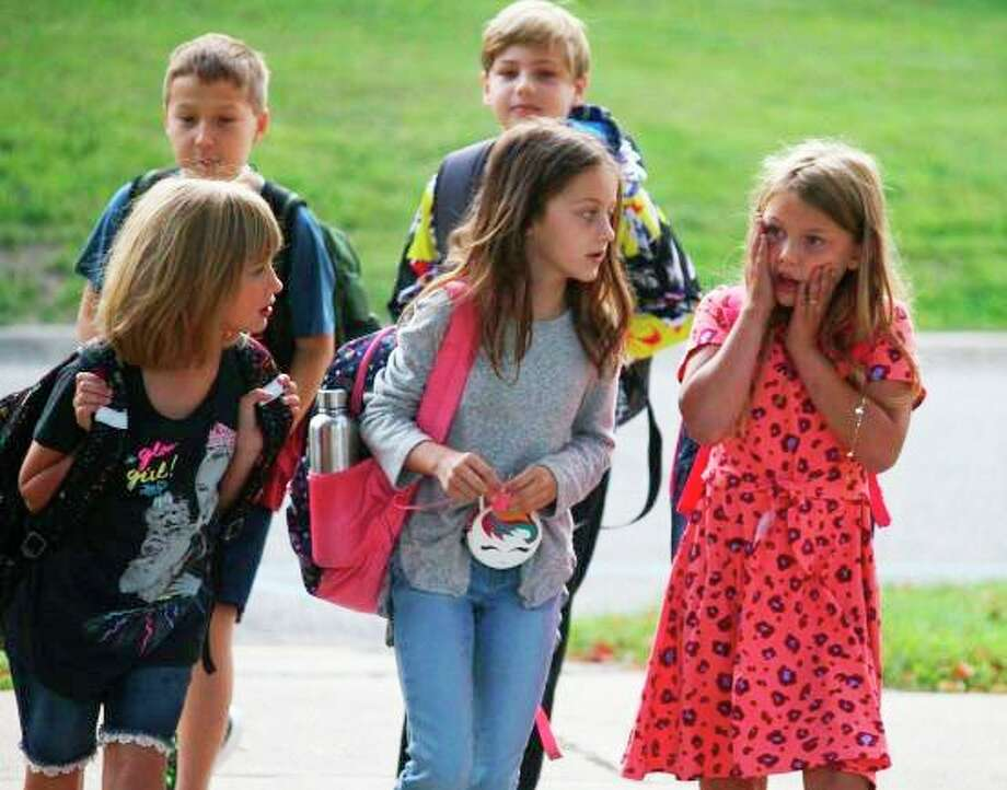 Students return to school on the first day of the 2019-2020 school year. School officials are planning for in-person options this year as well but remain uncertain about what it will look like for returning students. (Pioneer file photo)