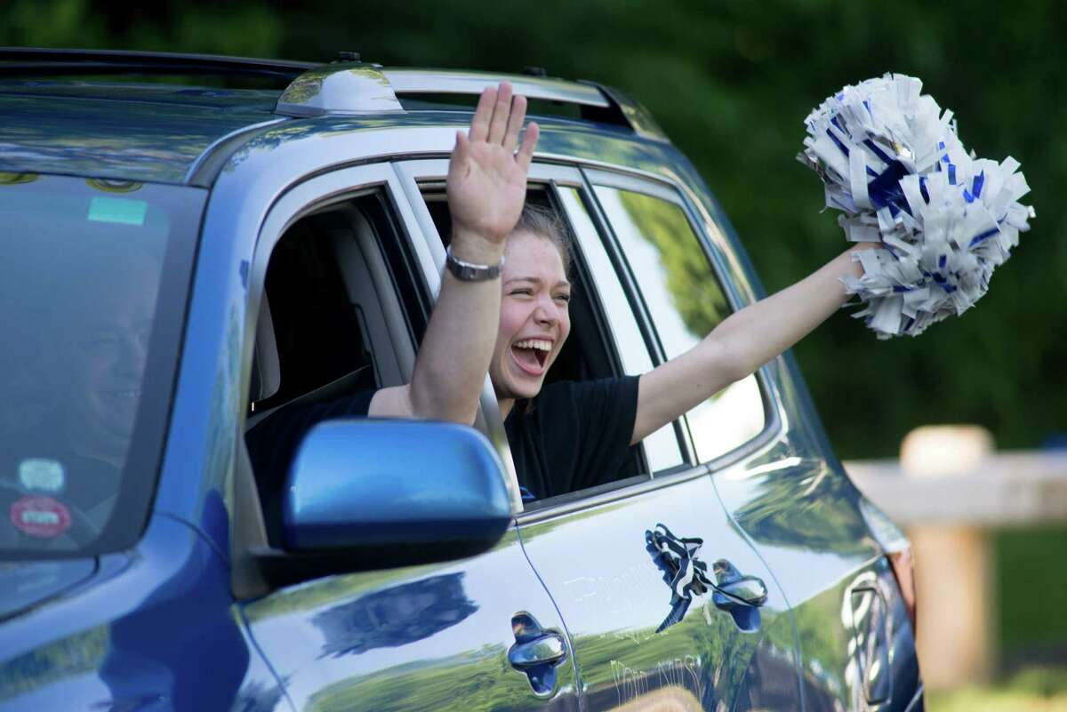 Darien High held a wave-through graduation car parade for the Class of 2020 seniors on the morning of June 12, after postponing it due to weather from June 11.