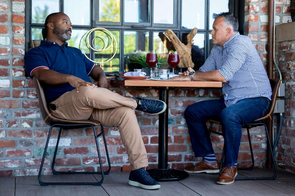 Anthony Beckley of San Francisco (left) and Into Alegre of Phoenix, Arizona enjoy outdoor dining at Teleferic Barcelona in Walnut Creek, Calif. Tuesday, June 9, 2020. Outdoor dining will reopen in Alameda County starting Friday.