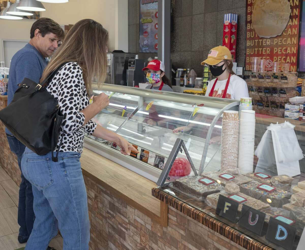 Judi and Rick Manis look over the handmade ice cream flavors 06/12/2020 at Fountainville. Tim Fischer/Reporter-Telegram
