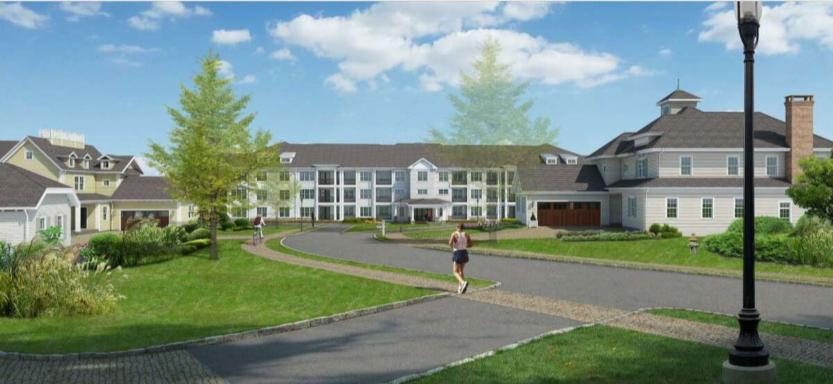 An artist's rendering of the 100-unit age restricted apartment building for seniors proposed by developer Dan Bertram. The proposed building is in the center of the rendering. Existing homes in the development are on either side.