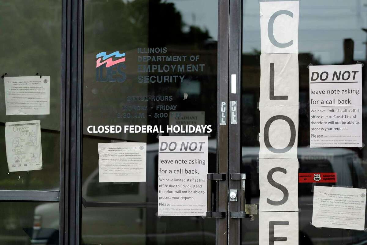 FILE - In this June 5, 2020, file photo, information signs are posted at the Illinois Department of Employment in Chicago. Newly minted college graduates are diving headfirst into one of the worst job markets in history. (AP Photo/Nam Y. Huh, File)