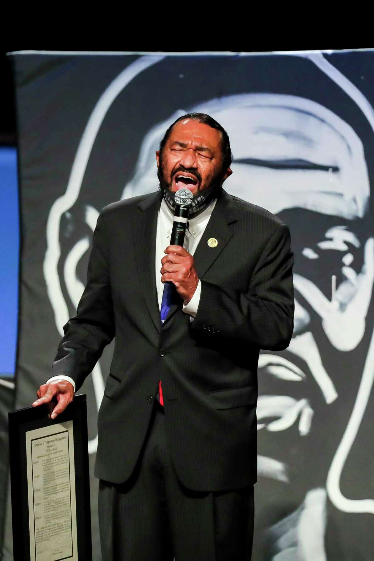 U.S. Rep. Al Green speaks during the funeral for George Floyd last week at The Fountain of Praise church in Houston. Floyd died after being restrained by Minneapolis Police officers on May 25. A reader suggests creating government incentives to cover higher education costs for African Americans.