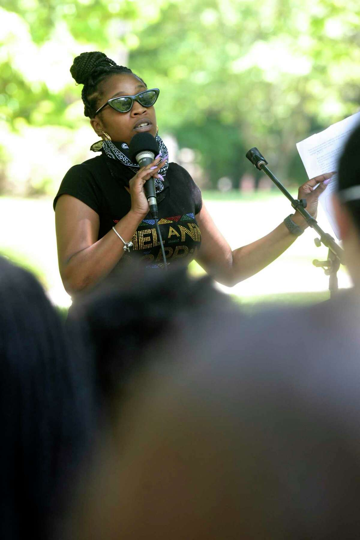 Vernay Snow, a Western Connecticut State University alumni, speaks after a march at the schools Midtown campus in support of the Black Lives Matter movement, Friday, June 12, 2020, in Danbury, Conn. One alumna, Vernay Snow, traveled nearly four hours from Maryland to speak, describing the racist remarks and bias she experienced from students, faculty and staff on campus.