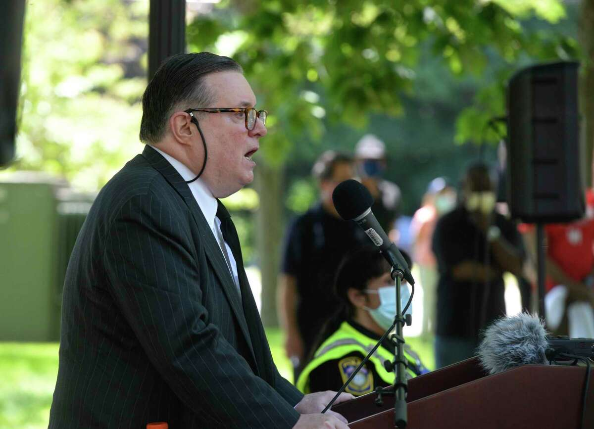 John B. Clark President of Western Connecticut State University speaks after a march at the schools Midtown campus in support of the Black Lives Matter movement, Friday, June 12, 2020, in Danbury, Conn. University President John Clark spoke as well, focusing on the need for the