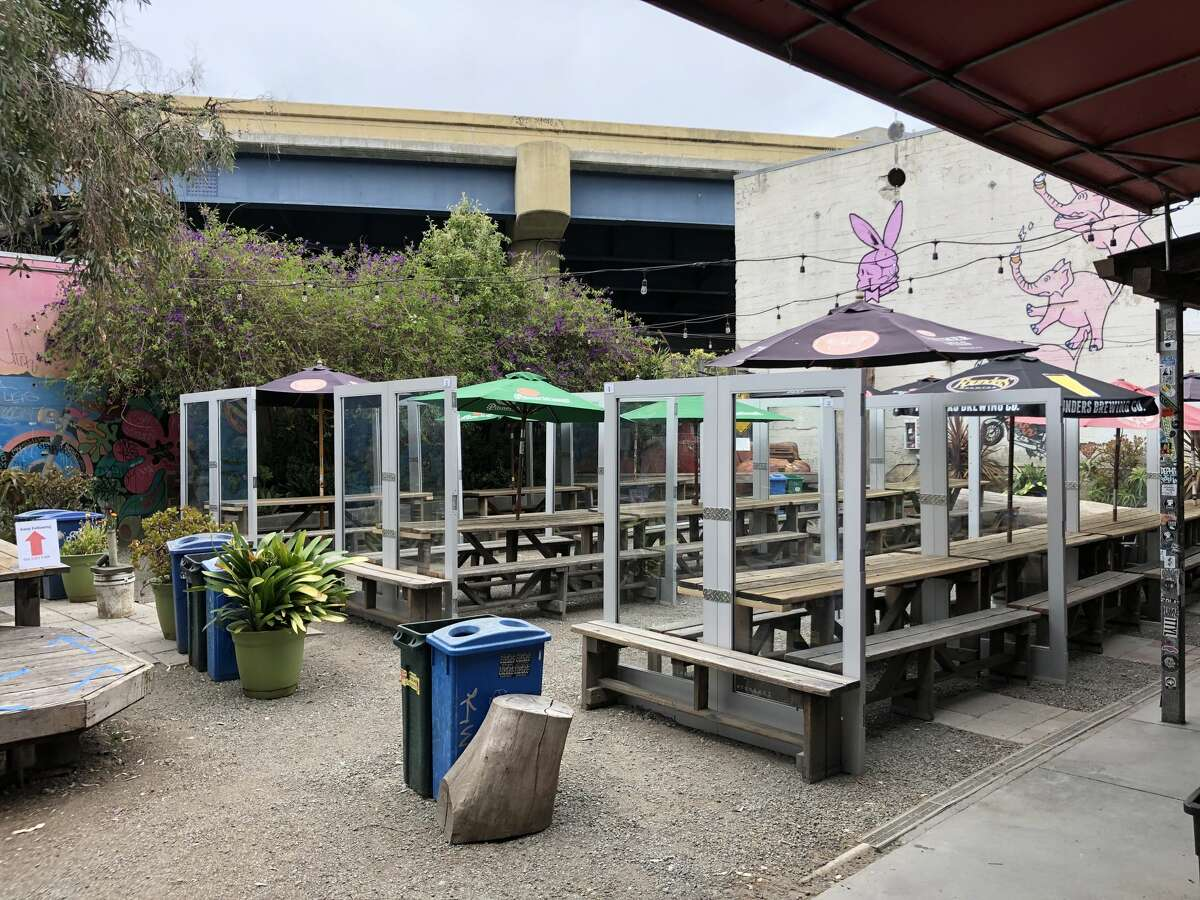 The outdoor patio at the Mission District institution still features the same sturdy picnic tables with patrons' names carved into the wood - but walls of glass bisect the tables to create protected seating areas.